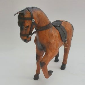 genuine leather horse toy standing with its leg up