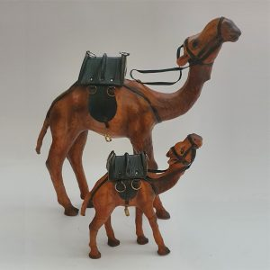 Two leather camel toys standing next to each other